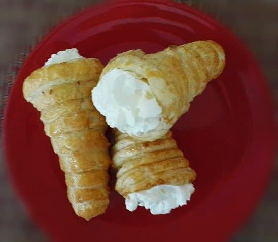 5.care fully remove the foil cones from baked pastry. fill the cornicopias  with whipped cream.