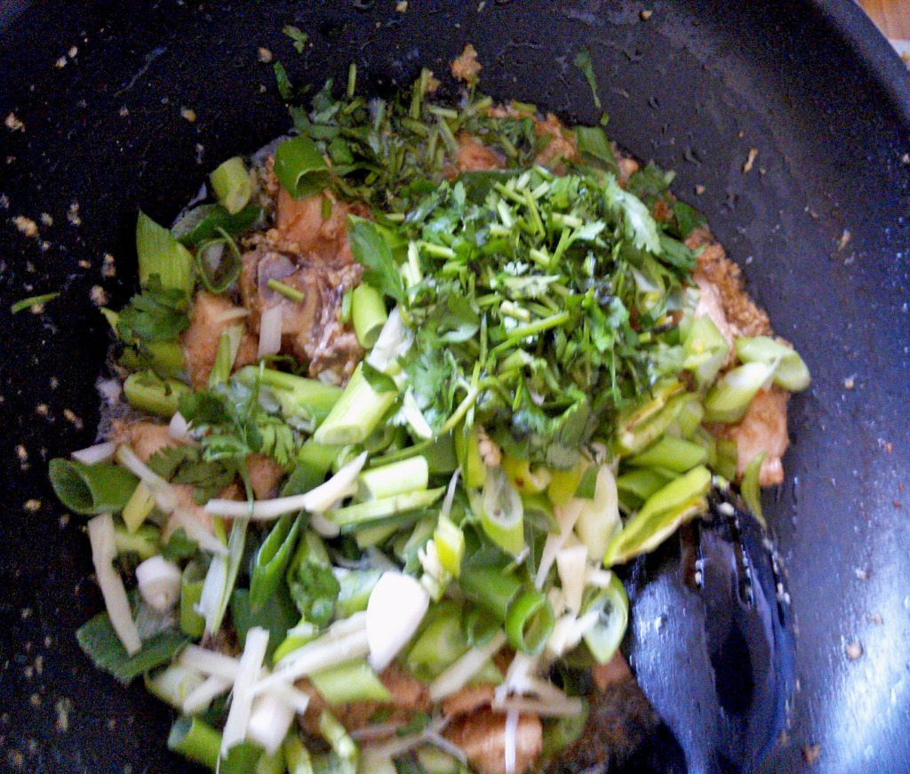 9. now add green onion,coriander,green chilies,ginger,black pepper.mix it well. immediately turn off the heat all green vegetables should not cook.