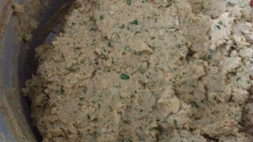 6. now chop the dal and chicken mixture very fine.add this in a bowl. add mesh potatoes, add chopped onion, chopped green chilies,coriander and mint leaves. Mix all these with hands and taste salt ,add some if u need. make kababs from this mixture.
