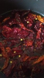 1. take 2 cups of dry  kasmiri red chilies. take out all seed as much as you can. in a pan add them with 3 cups of water. cook them on medium heat for 10-15 minutes. let them cool completely .