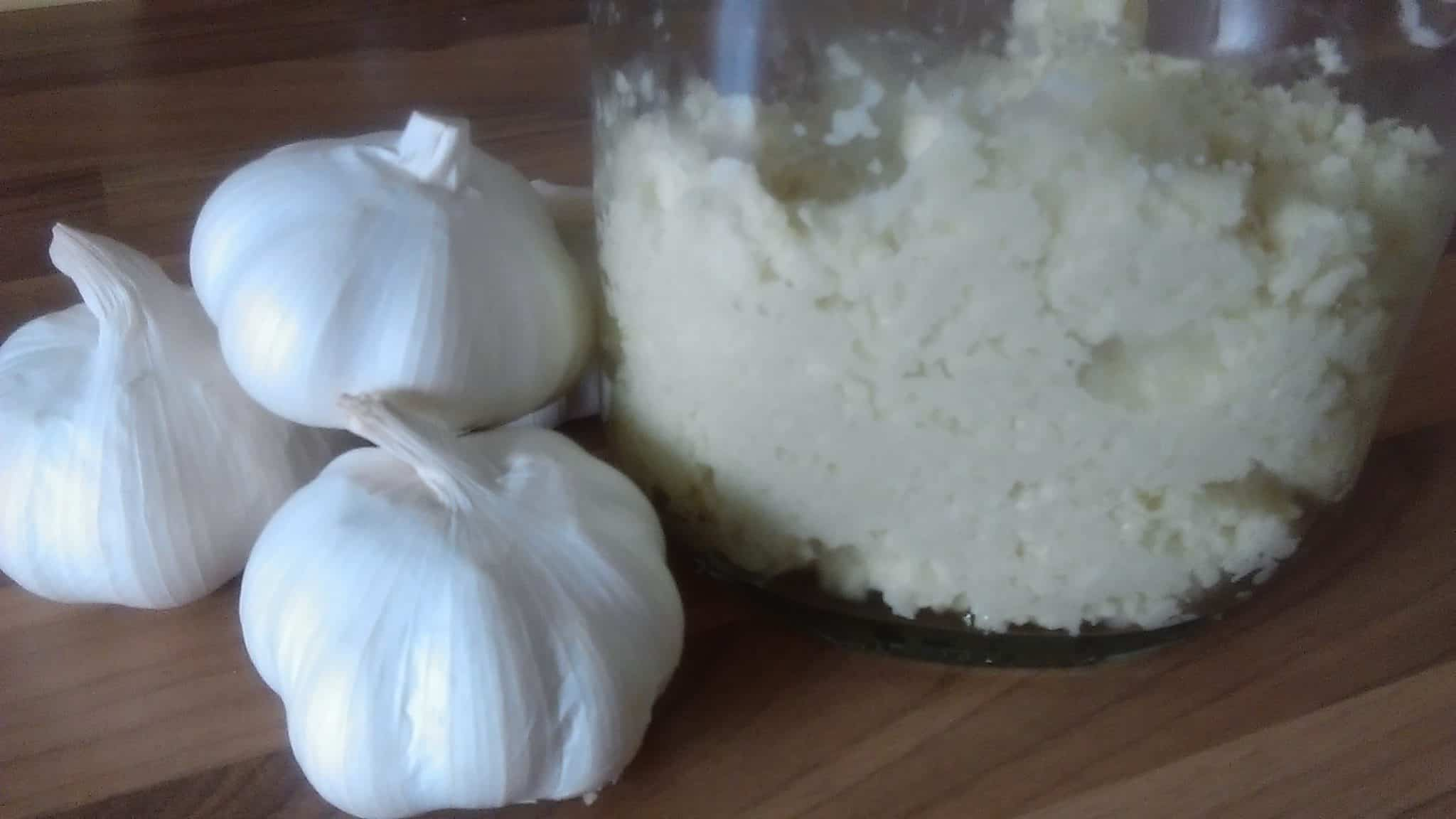 2. now in clean glass jar add this chopped garlic paste. keep this in fridge ,every time take out with clean dry spoon....you can keep this for at least 45 days in fridge. because of oil life of garlic will increase.