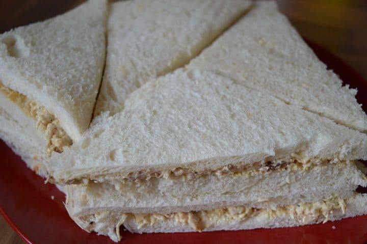 5. take 8 slices of bread, cut the edges and layer with this mixture. for good result bread should be fresh and soft.