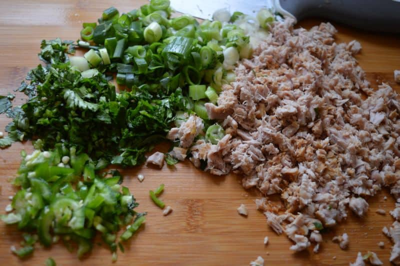 2. On a chopping board finely chop cooked fish,green chili, coriander, green onion.