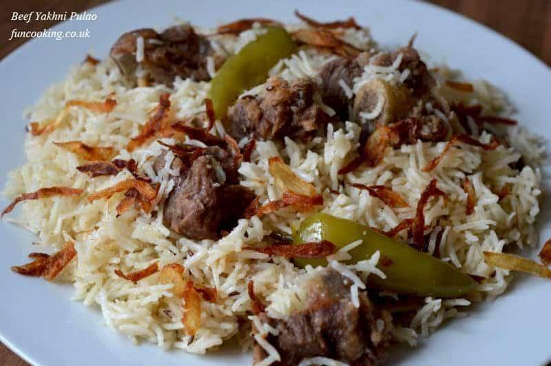 Beef yakhni pulao is ready. serve it with yogurt dip (raita)