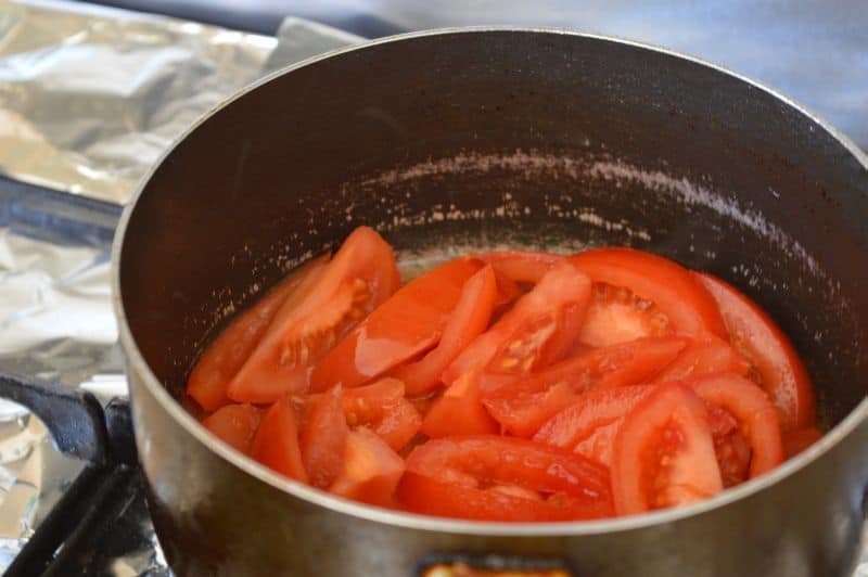 10. take sliced tomatoes,fry them with 2 tbsp oil on high heat for 2-3 minutes.