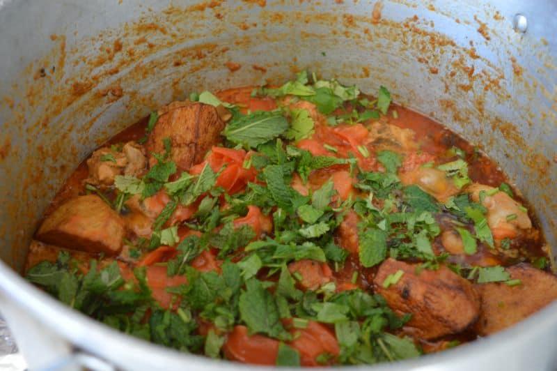 14. add half chopped coriander and mint on chicken gravy.