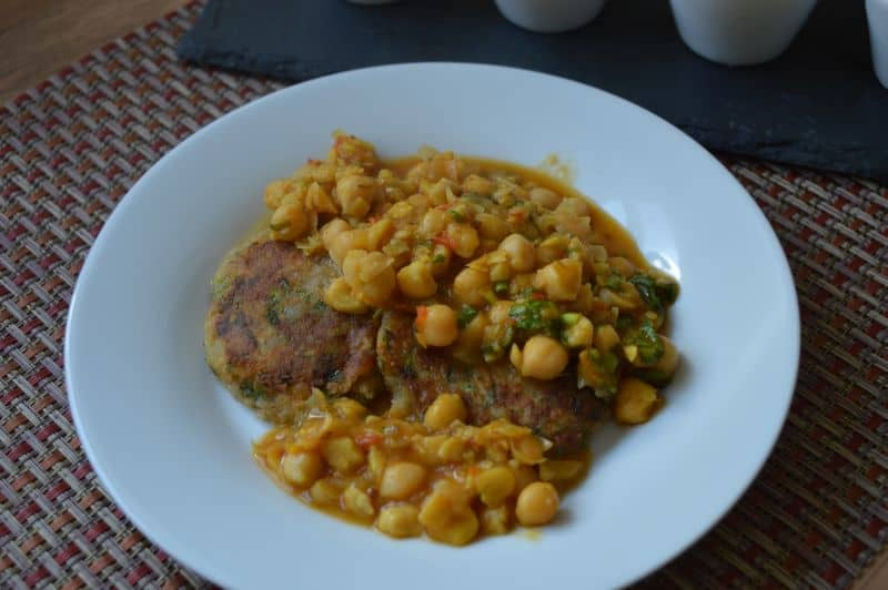 Keep potato Patties in a plate...pour some chickpea gravy on it.