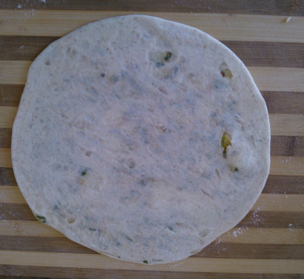 10.roll it and make a very thin roti