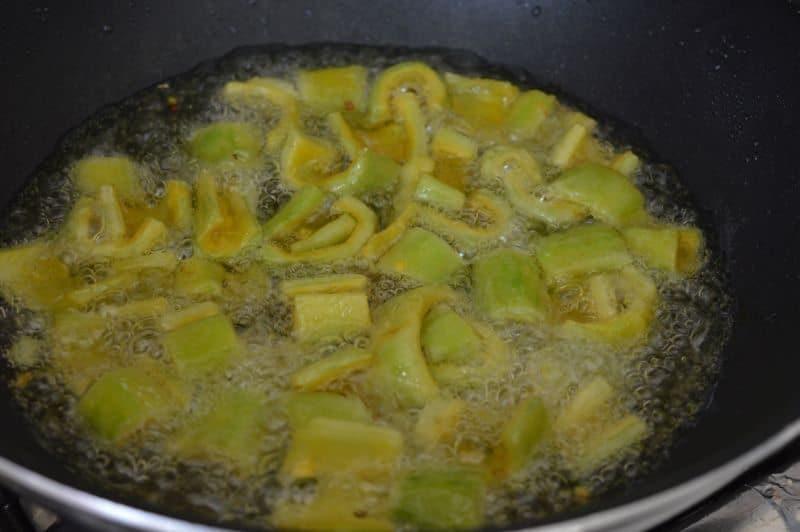 7. Heat oil in a pan ,add bitter gourd.